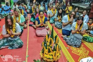 Volunteers take part in Buddhist ceremony